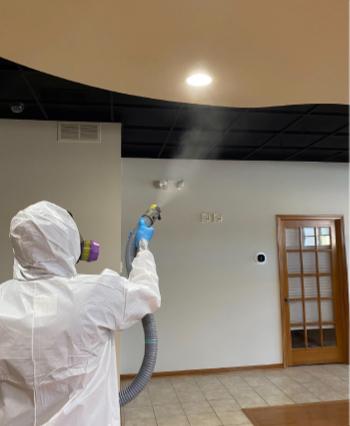 NuTech Disinfection Services | Man Spraying To Defeat Coronavirus